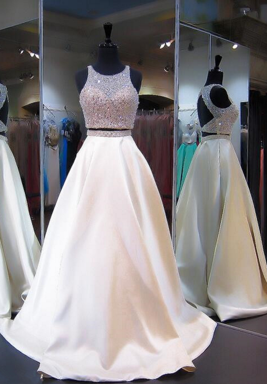 Two ball gowns with beaded head, evening dresses