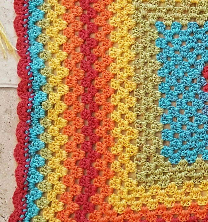 Multi colored crocheted baby blanket