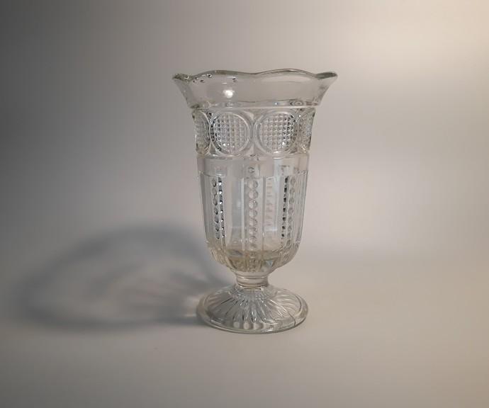 Clear glass celery vase.