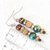 Dangle Earrings beaded with Natural Wood and lots of Sparkle
