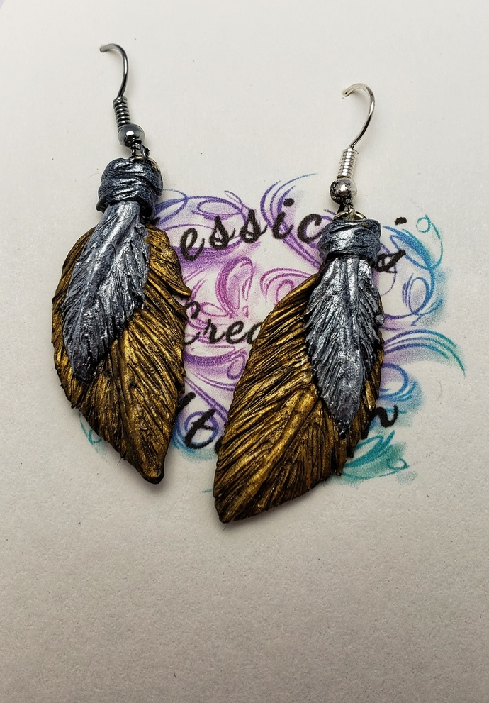 Polymer clay double feathers in silver and gold