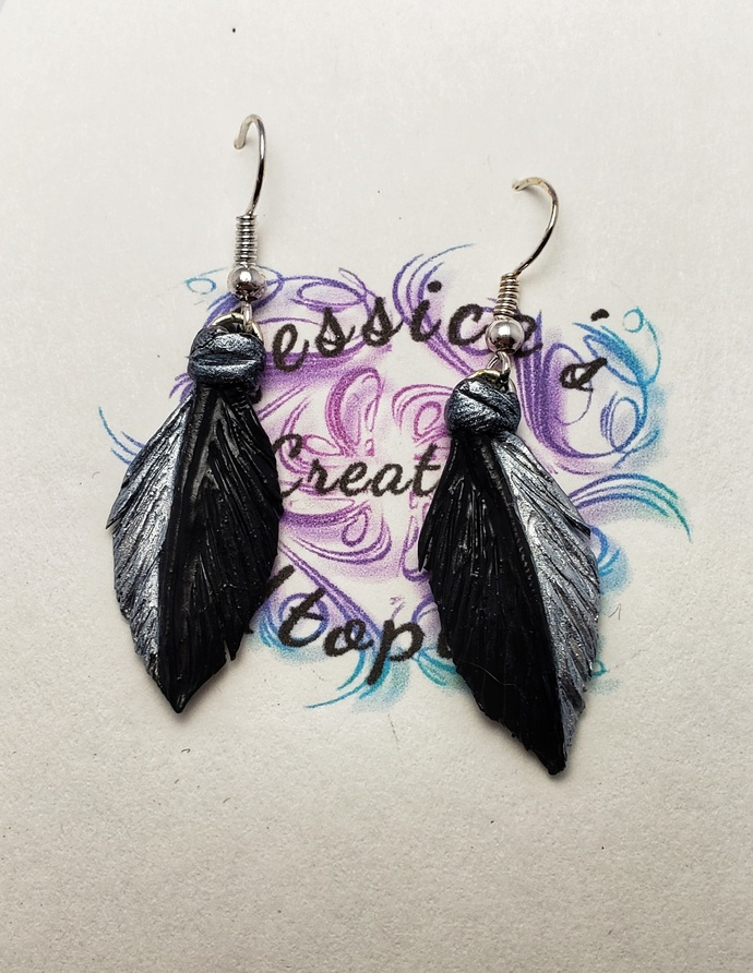 Polymer clay feather earrings two tone silver and black.