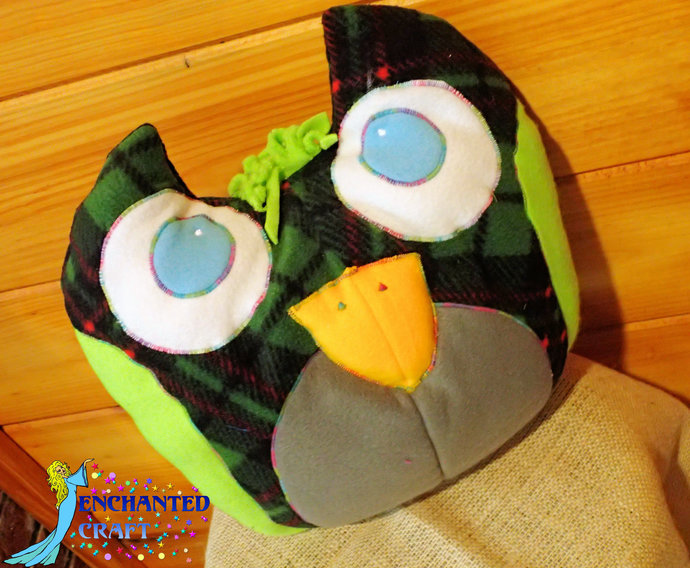 Fun Owl Plushie pillow in forest green, black, lime, grey, and blue plush