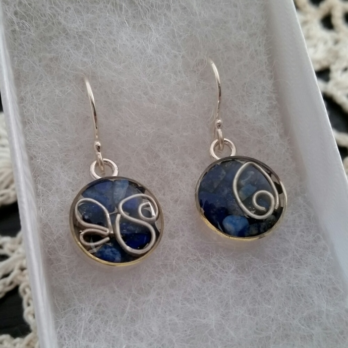 Sterling silver drop earrings with resin embedded metal shapes and lapis lazuli