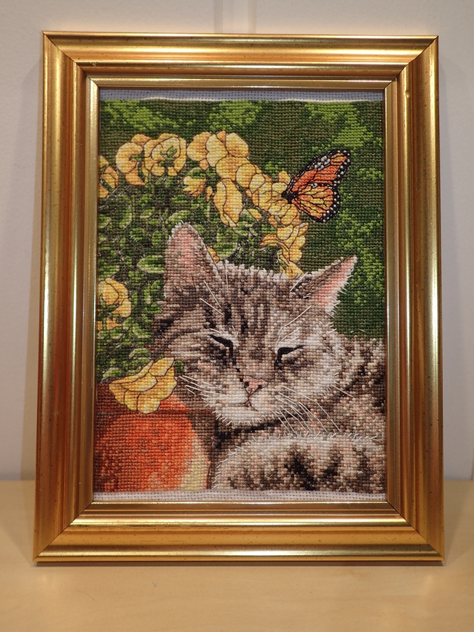 Cat and butterfly cross stitched picture, finished and framed