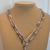 Scarf necklace - Silvered - Short - Arrow and feather charms
