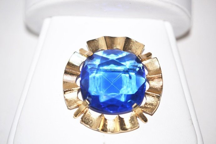 Signed Star Blue Faceted Rhinestone in Gold Tone Brooch