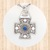 Sterling Silver Stacked Cross Pendant  with Circular Designs and 5mm Blue