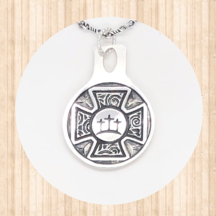 Sterling Silver. Circular Pendant with Large Cross and 3 Smaller Crosses at