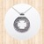 Sterling Silver Circular Pendant with Abstract Background and Cutout Cross.
