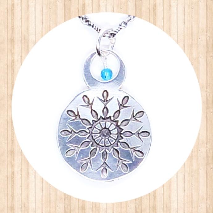 Sterling Silver Circular Snowflake Pendant with 4mm Round Swarovski Crystal