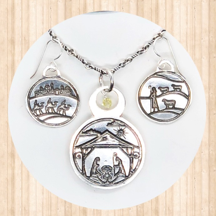 Sterling Silver Circular Pendant with Nativity Scene and 4mm Swarovski Crystal.