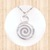 Sterling Silver. Circular Pendant  with Open Swirl.