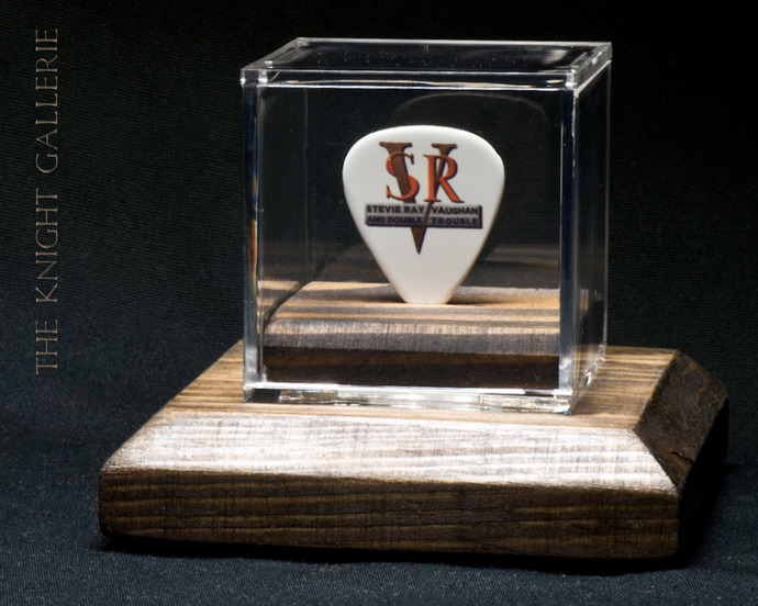 Commemorative guitar pick and display case: SRV
