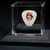 Commemorative guitar pick and display case: George Harrison