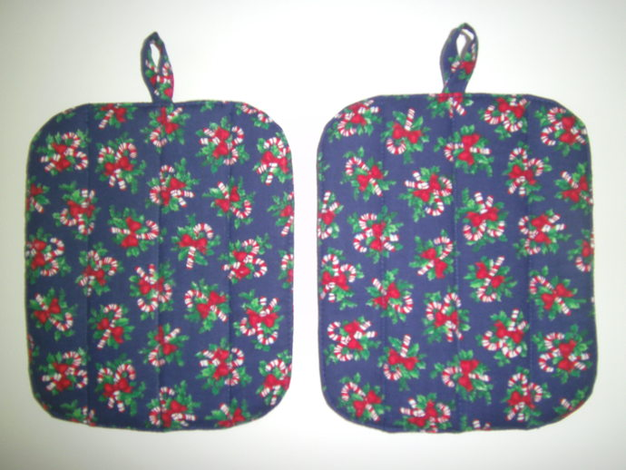 Fun candy canes tied with red bows look edible on this 2-Piece Holiday POTHOLDER