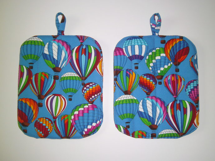 Bright and colorful Hot Air Balloons race across the sky on our 2-Piece