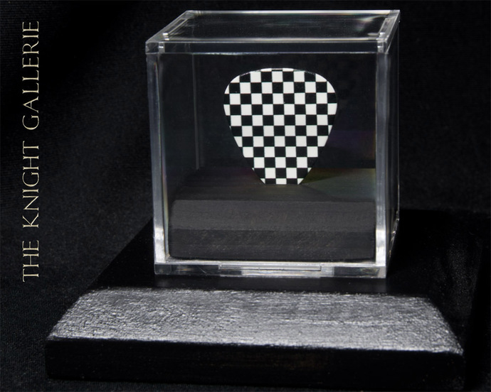 Checkerboard guitar pick and display ensemble