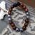 Hematite and sandalwood beads with lava stones. 10mm stretch bracelet