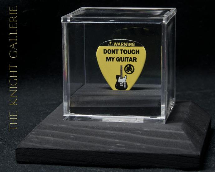 Guitar pick display ensemble. Don't touch my guitar!
