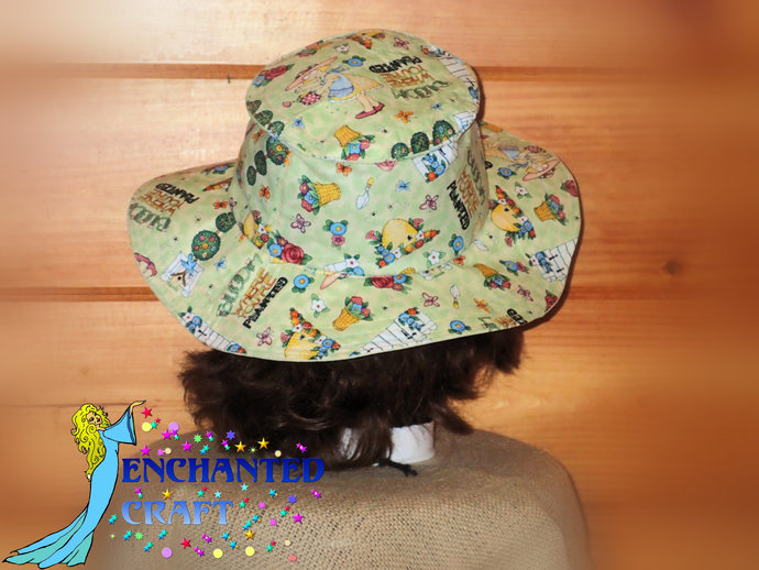 Travel Sun Hat- lays flat in a suitcase or tote in fun garden fabric pollinator,