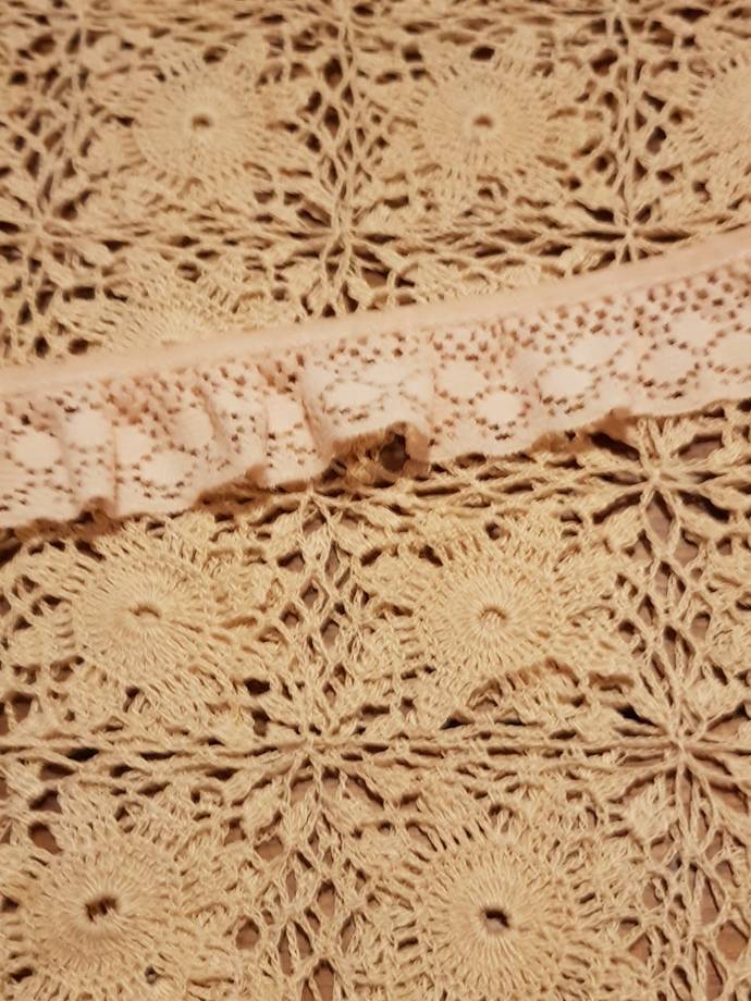 Peach gathered lace trim