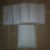 HM124 (2 Pieces) Machine Stitched Glassine Looking Pockets Black Thread