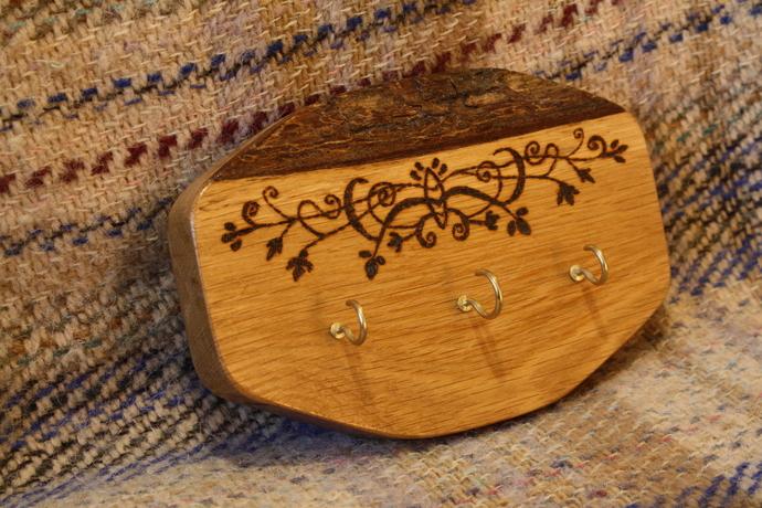 Handmade wooden key holder with decorative wood burned design