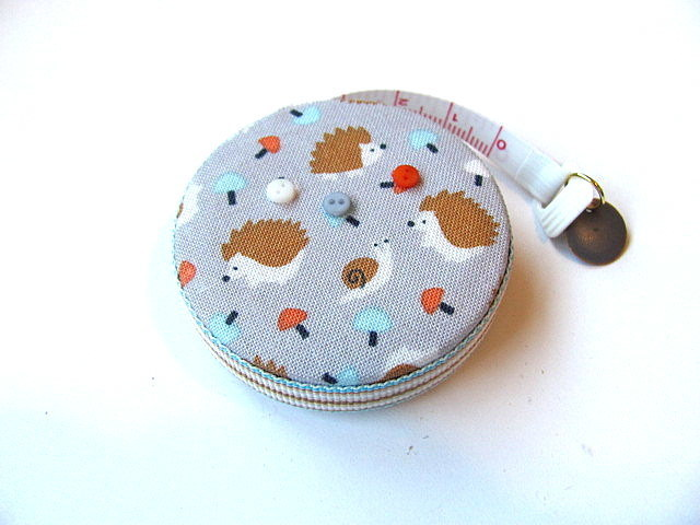 Tape Measure Hedgehogs in a Field Retractable Measuring Tape