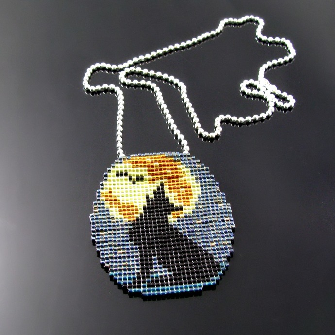Bead loomed howling coyote and full moon pendant