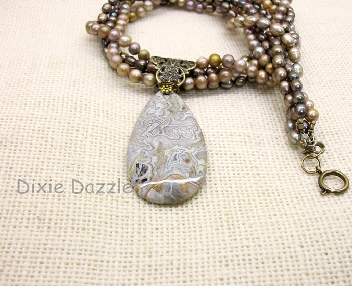 Multistrand pearl necklace with crazy lace agate pendant, brown and beige