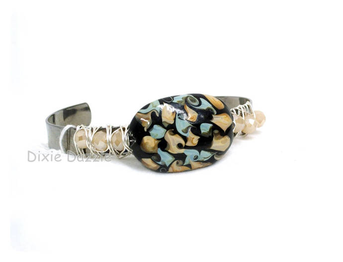 Lamp work beaded bracelet, champagne crystals, brown, black and blue cuff