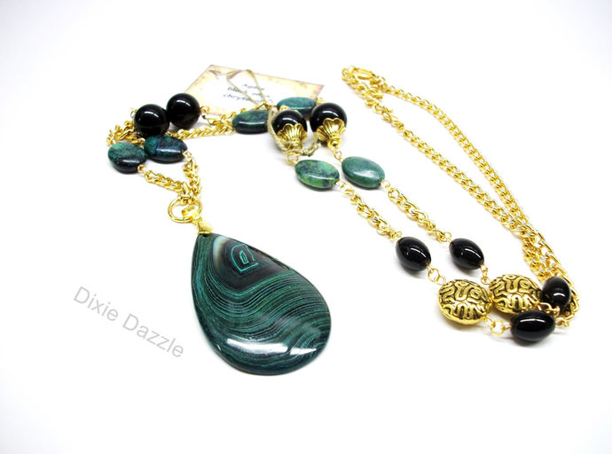 Long green necklace with large malachite stone pendant, black onyx, green and