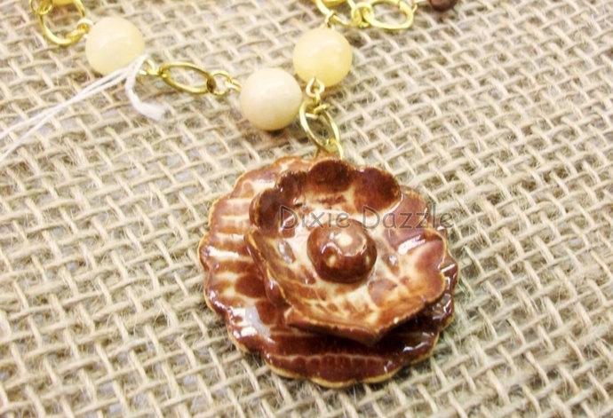 Ceramic flower bracelet with yellow jade. Stoneware clay charm by Dixie Dazzle,