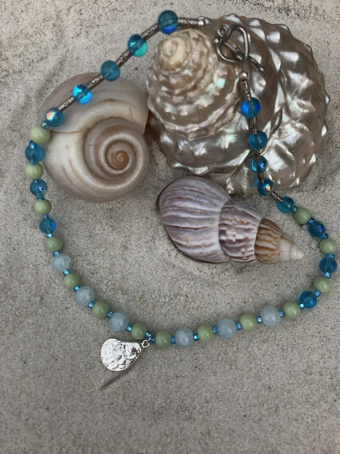 Blue glass necklace with a sterling silver oyster pendant
