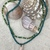 Teal and green beaded necklace with shell pendant