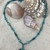 Beachy necklace with green stone pendant
