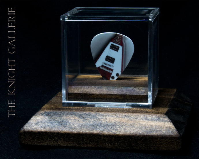 Commemorative Flying V Guitar Pick in a display case