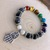 Handmade 7 chakra beaded bracelet for meditation with hamsa hand charm