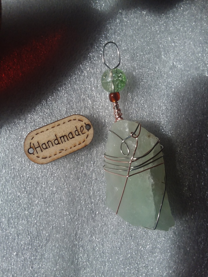 Crystal pendant in pale green wire wrapped in sterling and rose gold