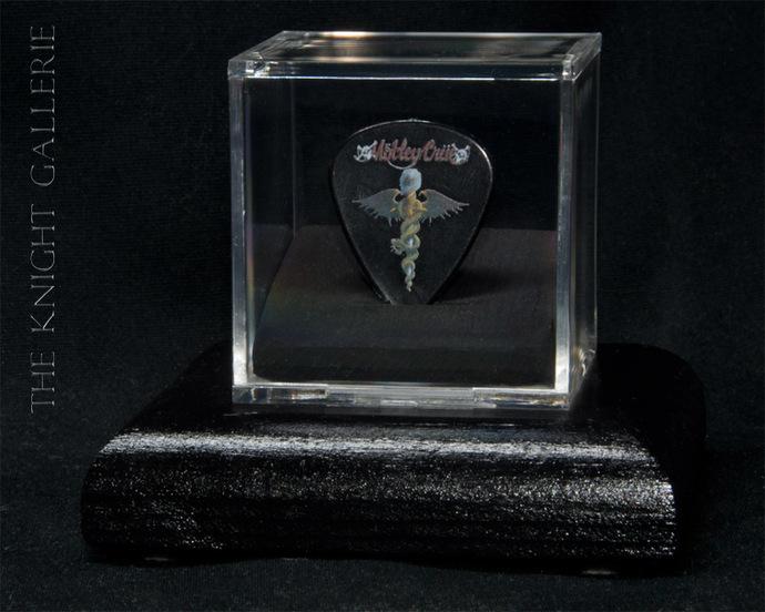 Commemorative guitar pick and display case: Motley Crue