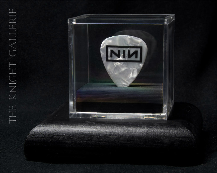 Nine Inch Nails guitar pick and display case