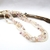 Multistrand twisted pearl necklace with crystal beads, assorted colors of