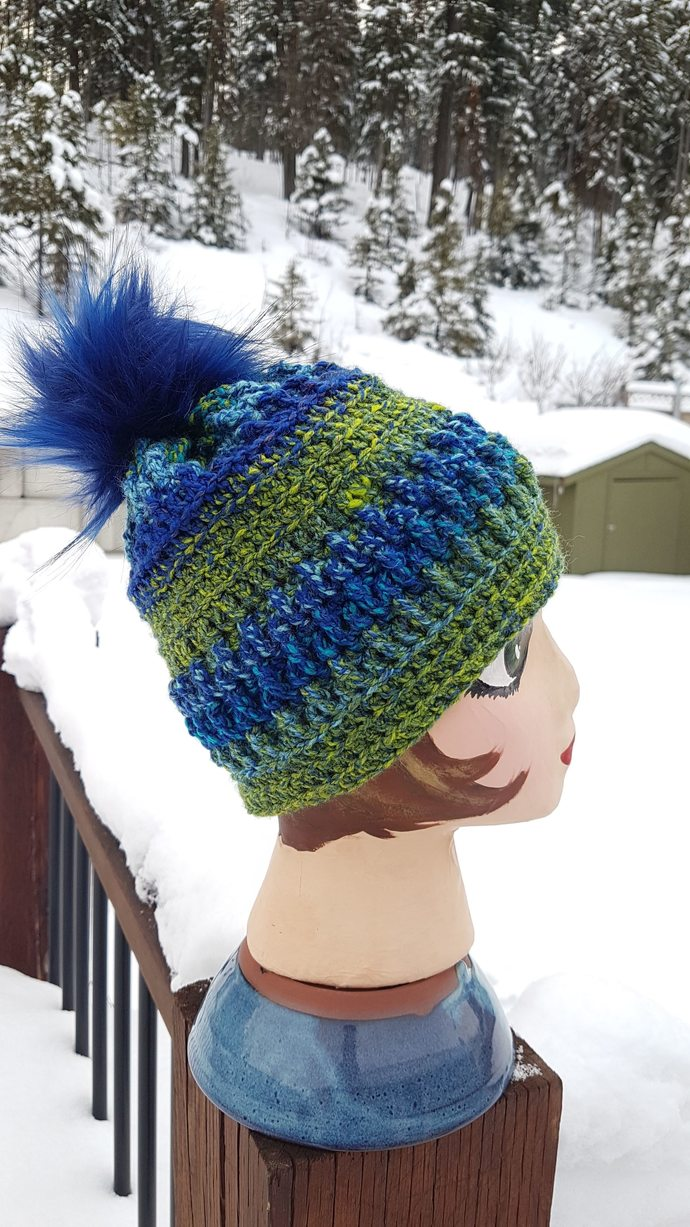 Warm textured blue & green Ripple Creek Toque (Beanie) with fluffy blue pom pom