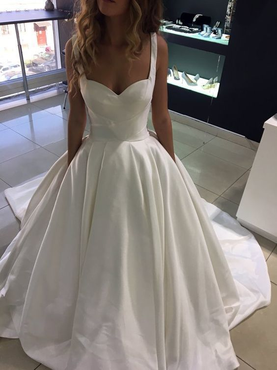 Minimalistic open wedding dress with straps