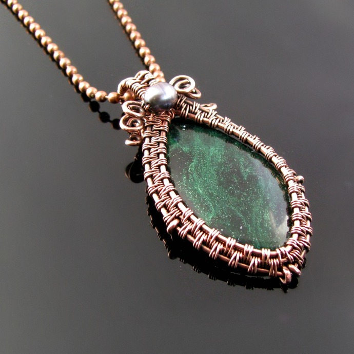 Wire woven pendant with green cabochon
