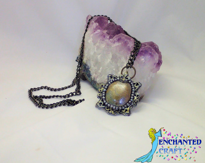 Dreamy goth styled necklace with a black chain faux stone vampire