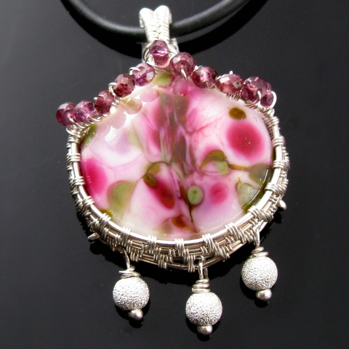 Spring pendant in sterling silver with glass cabochon and rhodolites
