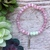 Handmade 6mm pink cat eye beaded bracelet with feather charm