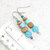 Dangle Earrings beaded in Blue, wood and silver-color beads with sparkle
